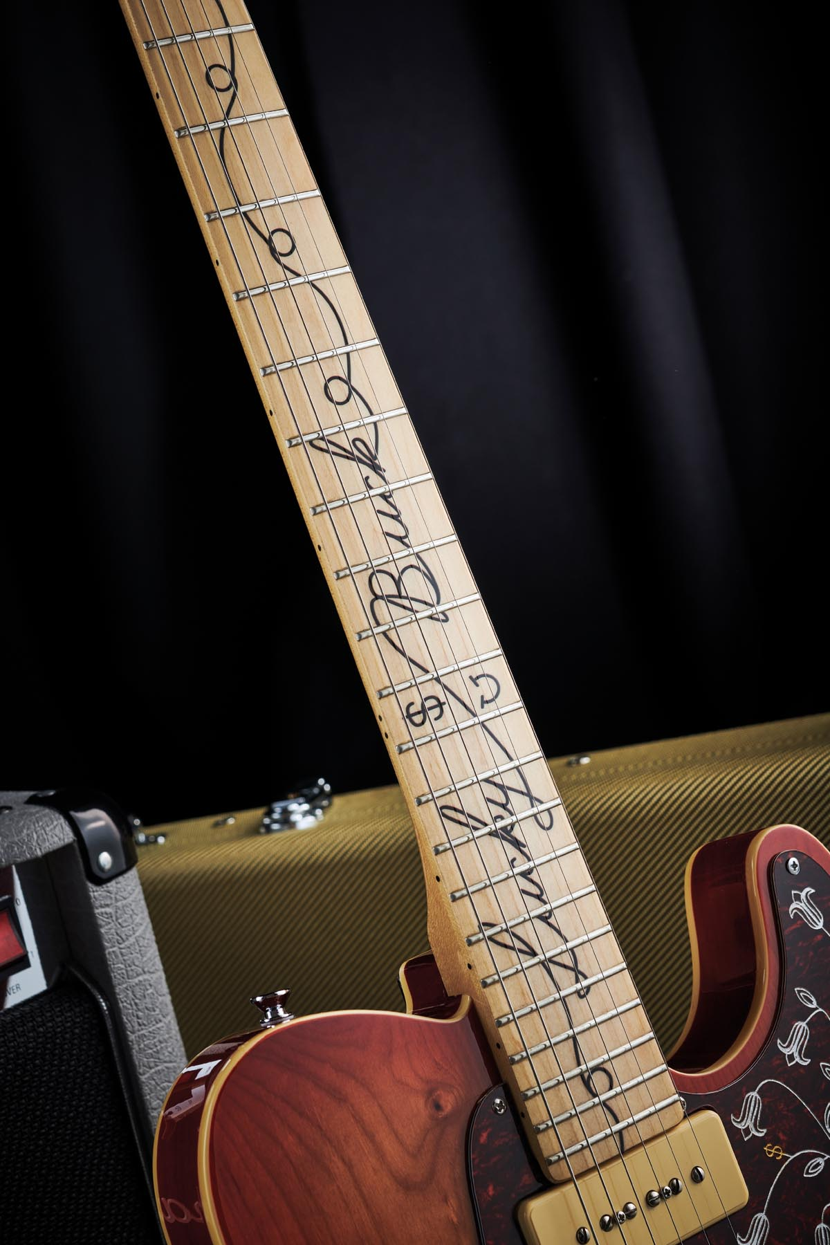 Like The Punkaster, Lucky Buck features a bolt-on maple neck with 22 medium frets and a slippery Graph Tech top nut. There's some cool decor here, too, in the shape of a rope decal that spells out the signature model's owner Lucky Buck.
