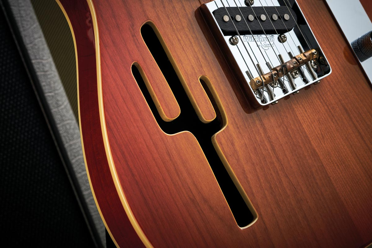 The Lucky Buck is a thinline model. In other words, its American alder body is semi-hollow making it lightweight and vibrant. The soundhole meets the country and western brief with a saguaro-cactus shape.