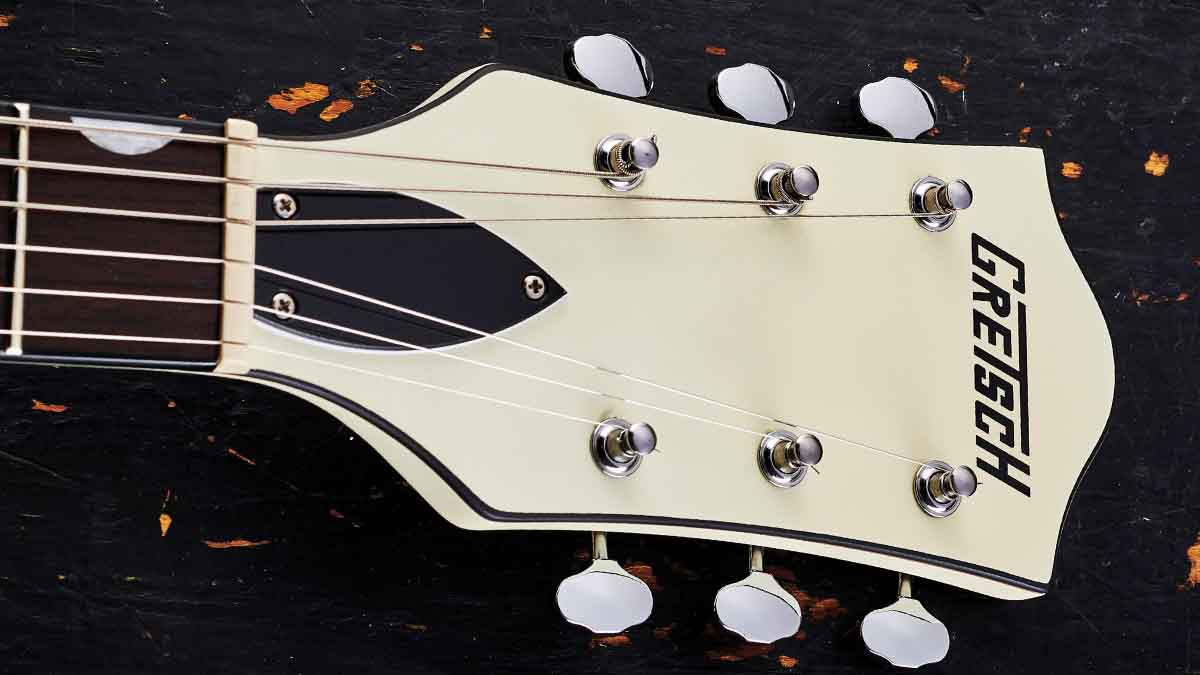 The late-50s-style headstock features Matte Vintage White paint front and back, as well as beautiful open-back tuners.