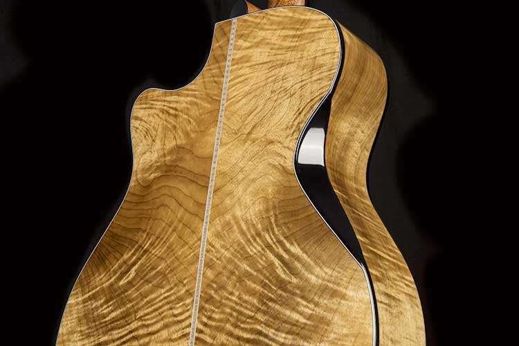 closeup of the Cort Gold-Edge acoustic-electric guitar's flamed myrtlewood back and sides and triple bevel cut